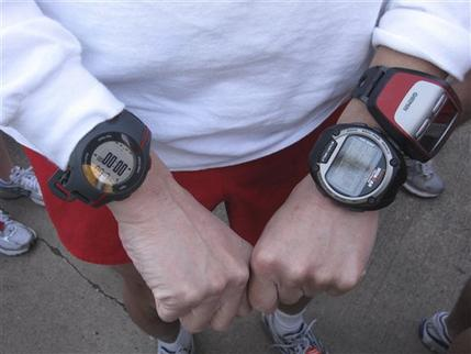 In this Feb. 13, 2011 photo, a marathon runner, attending the Mardi Gras Marathon, displays three GPS running aides, the Garmin Forerunner 110, left, the Timex Ironman Global Trainer, and the Garmin  Forerunner 305, right. (AP Photo)